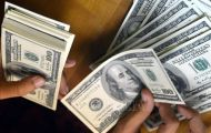 Tỷ giá trung tâm tiếp tục tăng, USD trên thị trường tự do giảm